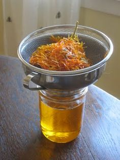 When I took a spill off my bike last summer I ended up with a skinned knee and leg.   I used calendula oil and it was both soothing and seemed to heal faster.  This is a recipe for a Calendula Oil infusion.