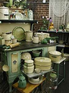 This is a really cute vintage kitchen with all of the pots, pans and utensils you need.  Did your family have any of these?