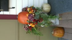 Fall porch idea...Decorative planter, pumpkin, fall leaves & flowers in foam.  Let the creativity flow!