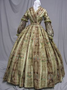 "1860's Civil War Era Silk Sheer Print Dress Major Museum de-accession | eBay seller svpmeow1; bust: 31""; waist: 21""; skirt length: 43""; hem circumference: 164"". Completely lined in off white cotton, purchased from Augusta auction, damage to silk in bodice, sleeve, some dame to other sleeves, both underarms and one of back sides, bodice missing some hooks & eyes"