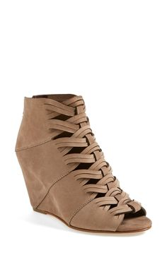 Obsessed with these peep toe wedge booties! They'll look gorgeous with a pair of skinny jeans.