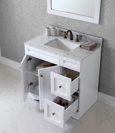 "Elise 36"" Single Square Sink White Top Vanity in White with Mirror The Elise bathroom vanity will give you that aesthetic pleasure by offering simplicity while still maintaining class. High quality solid wood oak retains the long-lasting construction of the design. This vanity is pleasingly finished in white as well as espresso. It is further enhanced with a sleek Italian Carrara marble countertop, a matching framed mirror, along with designer brushed nickel hardware. The Elise offers…"