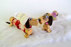 Puppy love!  https://www.etsy.com/listing/177210685/dachshund-dog-in-winter-wine-cork-puppy?ref=listing-shop-header-1