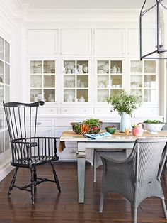 Dream kitchen alert: This one has a farmhouse table that seats 12. #diningrooms #kitchens