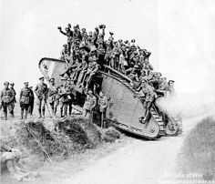 Members of the 5th Canadian Mounted Rifles return from combat piled on a tank August 1918 .Battle of Amiens