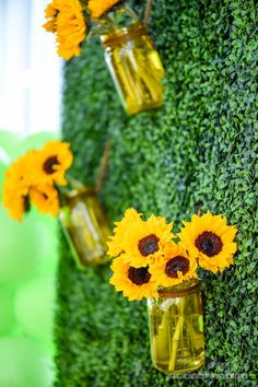 Sunflowers in mason jars from Minnie Mouse Sunflower Garden Party at Kara's…