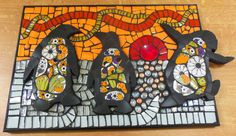 """""""Sunset Penguins"""" Mosaic - a mixture of tiles, crockery and a button, mounted on plywood. A3 sized picture. My first ever mosaic! Made by Flick Gillett, October 2014"""