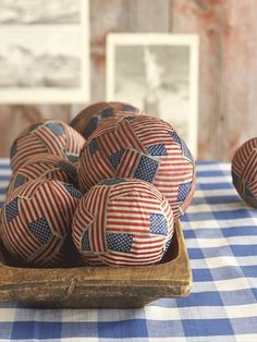 Happy Fourth of July!  Just blow up balloons and get a pack of the flags. use mode podge and glue down. pop balloon and pull out before sealing up the entire ball. Cool new rustic centerpieces for your home!