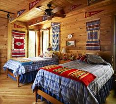West by Southwest This would be a wonderful bedroom for boys, or bunkhouse for guests. The beautiful wood walls, ceiling and floors mean only simple decorations are needed. Matching bedspreads are set apart by Southwest-style blankets and wall hangings. What a great place for cowpokes to rest after a hard day ropin' and ridin'!