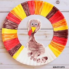 Looking for an easy Thanksgiving crafts for kids? Make this adorable footprint turkey wreath that you can also use as decoration.