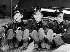 The original Three Stooges in their film debut, Soup to Nuts. Shemp Howard (far left) was the original third Stooge before his youngest brother Curly Howard assumed the role.