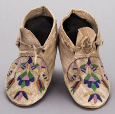 A PAIR OF SANTEE SIOUX BEADED HIDE MOCCASINS