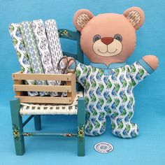 """Bear in Pajamas"" is a Cut and Sew Softie fabric panel. This is a do it yourself project with the instructions on the fabric panel. The fabrics on the chair are also available in my Spoonflower shop. Link in Profile."