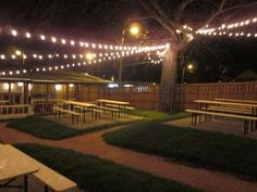 benches, tables, grass, lights -- pharmacy beer garden nashville