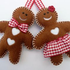 Mr & Mrs Gingerbread Felt Decorations By Devonly Crafts @Folksy: £10.00. This gorgeous pair of felt characters are hand stitched by me in a little corner of Devon! Mr Gingerbread has a handsome red bow tie & Mrs Gingerbread has a pretty gingham skirt & a flower in her hair. Each character is double-sided, measuring approx. 10cm & has a red gingham ribbon loop attached.