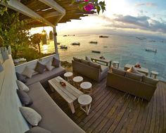 """Batu Karang Lembongan Resort & Day Spa have now opened the second stage to The Deck cafe & bar, The """"Lower"""" Deck. Built out over the cliff edge overlooking the aqua water, seaweed farms and surf breaks this space offers a relaxing lounge vibe with the most incredible views."""