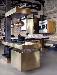 brushed brass feels urban and luxe in this industrial kitchen.