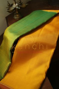 Yellow and green half and half style kanchipuram saree.