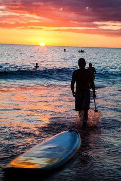 Summer beach bliss ~ surfing at sunset.