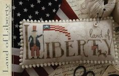 With Thy Needle and Thread Land of Liberty - Cross Stitch Pattern. Model stitched on 40 Ct. Legacy Linen by Picture This Plus with Weeks Dye Works, Gentle Art S Cross Stitch Finishing, Cross Stitch Kits, Counted Cross Stitch Patterns, Cross Stitch Charts, Cross Stitch Designs, Cross Stitch Embroidery, Hand Embroidery, Needlepoint Patterns, Embroidery Patterns