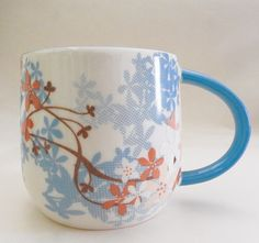 """STARBUCKS released this poetic and delightful 12 oz mug for our """" Tung Flower Festival """" in May of 2014."""