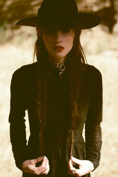 Wide brimmed hats and braids! God, I wish I had long enough hair for braids...