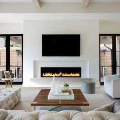 How about this black and white modern family room design? Coastal Virginia Magazine's Best Kitchen & Bathroom Remodeler - How about this black and white modern family room design? Coastal Virginia Magazine's Best Kitchen & Bathroom Remodeler - Living Room Decor Fireplace, Fireplace Tv Wall, Fireplace Remodel, Living Room Tv, Fireplace Design, Fireplace Ideas, Fireplace Modern, Linear Fireplace, Basement Fireplace