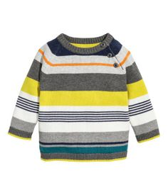 Fine-knit sweater in soft cotton with long raglan sleeves and buttons at one shoulder.