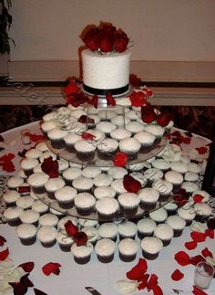 Black and white wedding cake with red roses and black and white cupcakes... by Celebrity Cake Studio ... http://celebritycakestudio.com