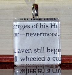 Edgar Allen Poe book page on glass tile pendant