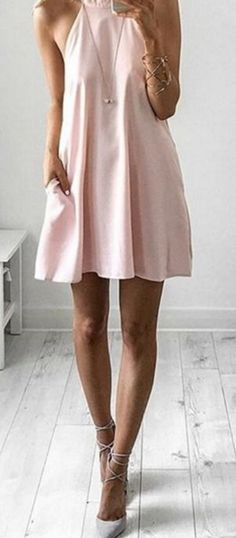 the I Need a Hero Light Pink Halter Dress does that on its own!