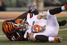 Cleveland Browns quarterback Johnny Manziel (2) is sacked by Cincinnati Bengals defensive tackle Geno Atkins (97) in the second half of an NFL football game, Thursday, Nov. 5, 2015, in Cincinnati. (AP Photo/Frank Victores)