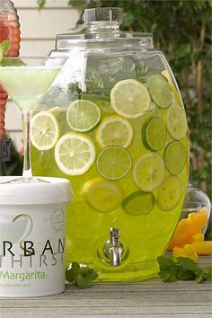 VIRGIN ISLANDS - I'd like to serve a traditional lime daiquiri from a dispenser similar to this.  But what food?  Or is food necessary when there is a steel band?  Maybe just beach chairs.