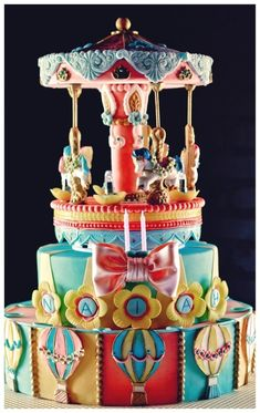 Birthday cake for a 2 year old girl..each tier has 3 flavors: mango chiffon, strawberry chiffon and pistachio with french meringue buttercream.  all decorations are edible except for the stick holding the ponies and the internal supports..top part actually spins..I used LED lights..cake sizes were 10 and 14..
