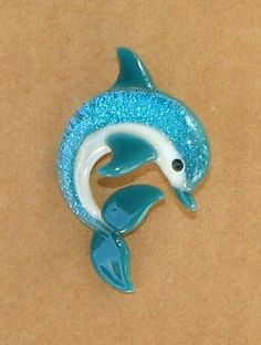 cute little dolphin.    Dolphin Glass Pendant  Created by Tom Heath by sanctuaryglass, $15.00