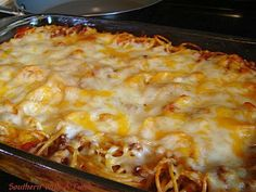 Spaghetti Pie Filling: 3 eggs, beaten 1 cup sour cream 1/2 cup Parmesan Cheese 1 cup Mozzarella Cheese 1 lb Spaghetti Noodles, cooked and cooled