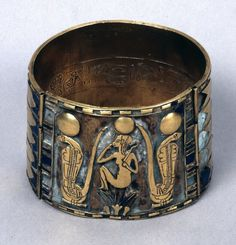 """Bracelets, Lapis Lazuli and gold, 940 BCE, 22nd Dynasty Ancient Egypt """"Gold cuff bracelet of Prince Nemareth: the inner side of the smaller segment of this bracelet is inscribed for a man with the..."""