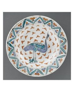 Dish with large blue bird on seedlings of red leaves - Musée national de la Renaissance (Ecouen)
