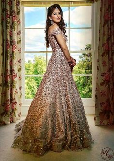 How stunning does this bride look in a largely flared evening gown, perfect for an engagement or reception ceremony? #manishmalhotra #designer #lehenga #indianbride #indianwedidng #modern #lehenga