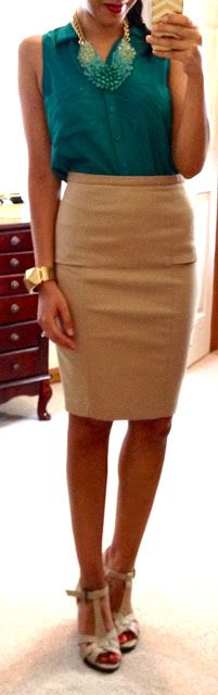 perfectly tucked, sleeveless button down and nipped pencil skirt.
