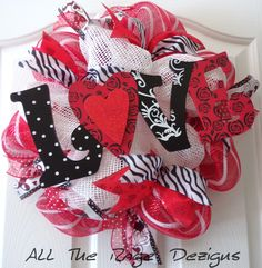 "Valentine ""Love"" Wreath- Super cute Valentine wreath about 18-19 inches consisting of white paper mesh, red w/white strip deco mesh, four gorgeous ribbons and beautiful Love sign.  Just the right amount of something to decorate your home or front door!  $43 https://www.Etsy.com/shop/AllTheRageDezigns"