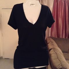 """PINK Victoria's Secret Sleepwear Top PINK Victoria's Secret Sleepwear Top is made of 60% Cotton and 40% Polyester.  Size XS. Color Black. Sleepwear. V-Neck design. The Length """"26. Laying flat """"15. This item is NOT new, It is used and in Good condition. Authentic and from a Smoke And Pet free home. All Offers through the offer button ONLY. Please use the Offer button, I WILL NOT negotiate in the comment section. Ask any questions BEFORE purchase. Thank You PINK Victoria's Secret Intimates…"""