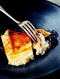 Blueberry Blintzes-Surrender yourself to tender, warm crepes folded around a cheese filling, topped with a succulent blueberry sauce.