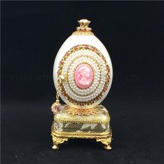 Musicbox goose eggshell art/Pearl jewelry box This exquisite and romantic Goose Egg Musical Box is delicately hand carved and adorned with faux pearls. It is genuine goose egg shell treated with reinforcement method. The egg opens with a hinge and it can hold treasures inside.