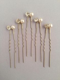 Crystal Pearl bridal hair pins. Perfect for brides or bridesmaids. -Made with Crystal rhinestones, Swarovski pearls and silver wire. -Pins can be worn scattered or clustered in the hair -Set includes five hair pins For larger quantities of sets, please feel free to get in touch. Hair Accessories For Women, Wedding Hair Accessories, Bridal Earrings, Wedding Jewelry, Loc Jewelry, Pearl Hair Pins, Wedding Hair Pins, Hair Beads, Bridal Hair And Makeup