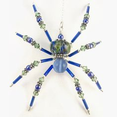 """Luna"" Sculptured Wire Spider in  Blue-Green and Sterling Silver by OzmayDesigns on Etsy ... the best kind of spider to have around! ;)"