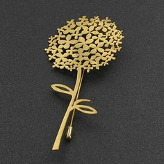 Brooch in the shape of golden Ajisai Flower of contemporary design.  Made of hypoallergenic surgical steel and golden sterling silver.  4,5 inches