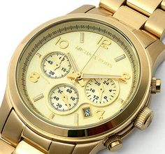 MK5055 - Thanks to my tax return (I love you H&R Block) I am the proud owner of this big honkin' gold watch. I know it's overly popular and bordering on cliche. But I love it. It's the big ol' man-watch of my dreams.