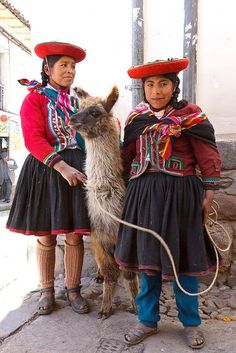 Two Inca women with their llama