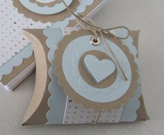 Baby blue pillow boxes make great favors at your next baby shower! Fill with Jordan almonds or other special treats. Find brown kraft cardstock to make this project at www.cardstockshop.com.